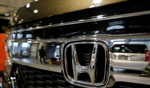 The emblem of Japan's Honda Motor Co. is displayed on one of the company's latest cars at a showroom in Tokyo on February 2, 2018. - Honda was expected to announce the company's nine-month earnings report later in the day on February 2. (Photo by Kazuhiro NOGI / AFP)