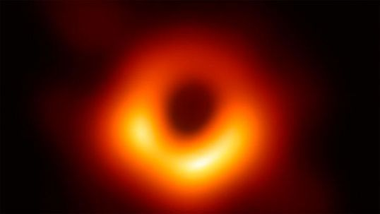 The first image captured from a black hole. Credit: EHT